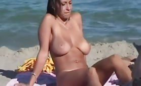 Gorgeous girl oiling her huge tits