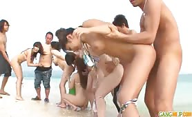 Group sex on the beach with Asian women